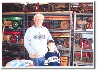 Gordon Westover with his grandson passing down the passion of Antique Wagons