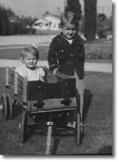 a young Gordon Westover, founder of Wagon Master Coaster in an antique wagon from 1944